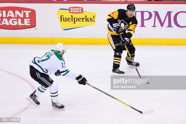 Pittsburgh Penguins Center Evgeni Malkin passes the puck while Dallas Stars Winger Devin Shore defends during the second period in the NHL game...