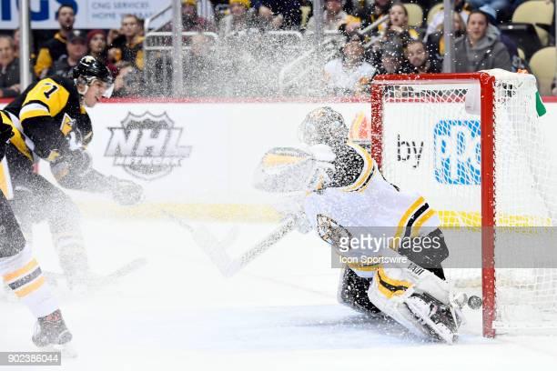 Pittsburgh Penguins Center Evgeni Malkin scores the game wining goal past Boston Bruins Goalie Tuukka Rask during the overtime period in the NHL game...