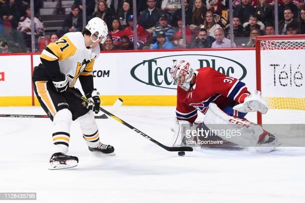 Pittsburgh Penguins center Evgeni Malkin shoots on Montreal Canadiens goalie Carey Price during the Pittsburgh Penguins versus the Montreal Canadiens...