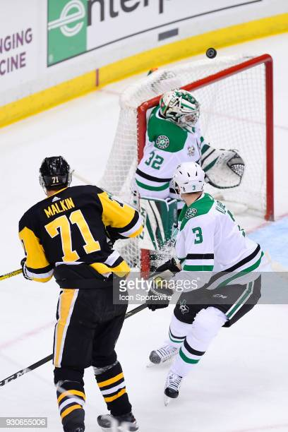Pittsburgh Penguins Center Evgeni Malkin shoots the puck over the net on Dallas Stars Goalie Kari Lehtonen during the second period in the NHL game...