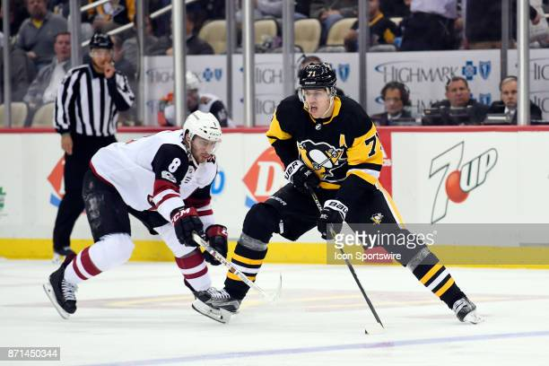 Pittsburgh Penguins Center Evgeni Malkin skates with the puck as Arizona Coyotes Right Wing Tobias Rieder defends during the second period in the NHL...