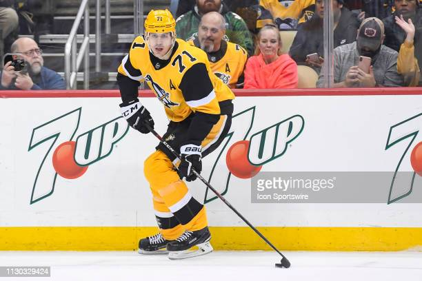 Pittsburgh Penguins Center Evgeni Malkin skates with the puck during the first period in the NHL game between the Pittsburgh Penguins and the...