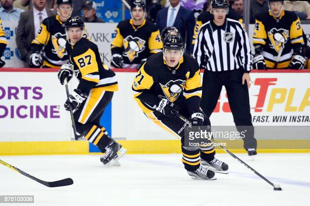 Pittsburgh Penguins Center Evgeni Malkin skates with the puck on the power play with Pittsburgh Penguins Center Sidney Crosby during the second...