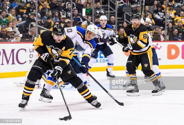 Pittsburgh Penguins Center Evgeni Malkin skates with the puck while St Louis Blues Left Wing Brayden Schenn defends during the second period in the...