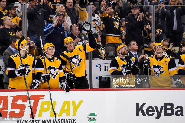 Pittsburgh Penguins Center Evgeni Malkin waves to the crowd after getting his 1000th NHL career point during the third period in the NHL game between...