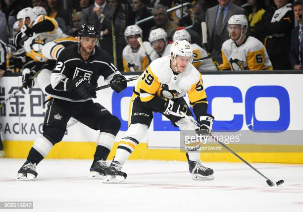 Pittsburgh Penguins Center Jake Guentzel keeps the puck away from Los Angeles Kings Left Wing Marian Gaborik during an NHL game between the...