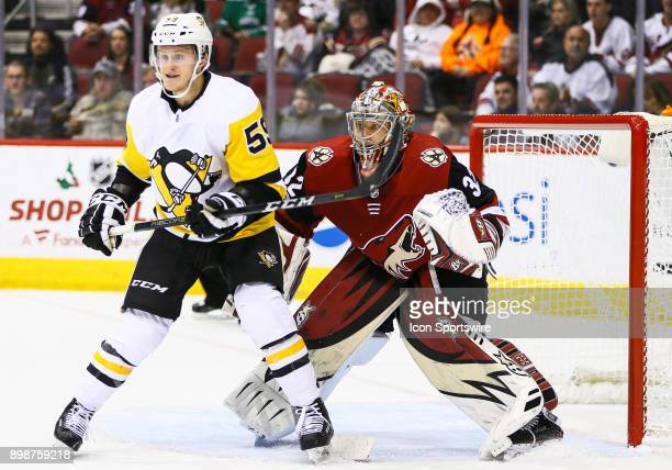Pittsburgh Penguins center Jake Guentzel sets up in front of the goalie during the NHL hockey game between the Pittsburgh Penguins and the Arizona...