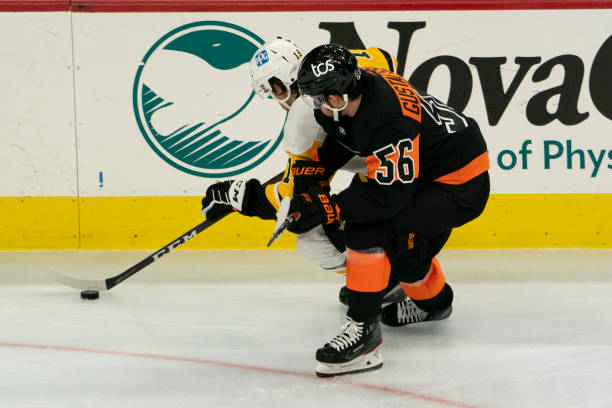 Pittsburgh Penguins Center Jared McCann and Philadelphia Flyers Defenceman Erik Gustafsson battle for the puck during the second period of a National...