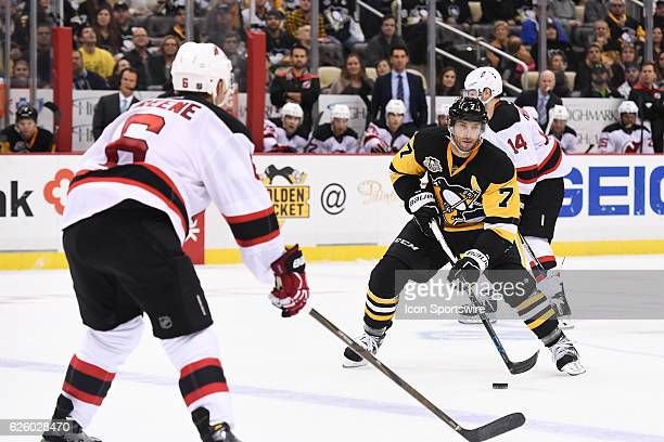 Pittsburgh Penguins Center Matt Cullen skates the puck into the zone as New Jersey Devils Defenceman Andy Greene defends during the overtime period...