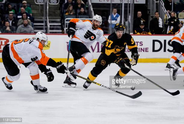 Pittsburgh Penguins Center Sidney Crosby and Philadelphia Flyers Defenseman Travis Sanheim and Philadelphia Flyers Center Sean Couturier defend...