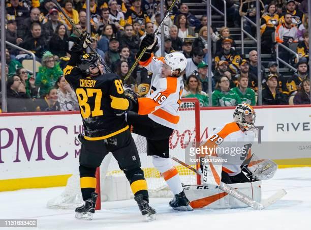 Pittsburgh Penguins Center Sidney Crosby and Philadelphia Flyers Center Nolan Patrick battle in front of Philadelphia Flyers Goalie Carter Hart...
