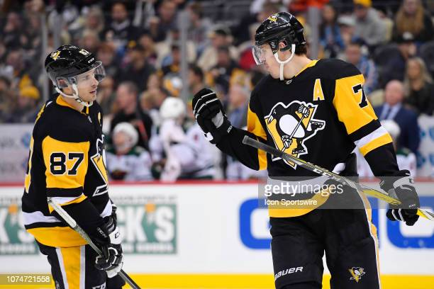 Pittsburgh Penguins Center Sidney Crosby and Pittsburgh Penguins Center Evgeni Malkin talk before a power play during the third period in the NHL...