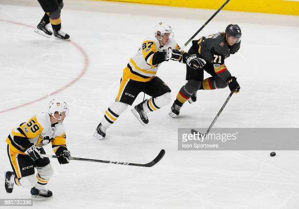 Pittsburgh Penguins center Sidney Crosby and Vegas Golden Knights center William Karlsson skate for the puck during the third period of a regular...