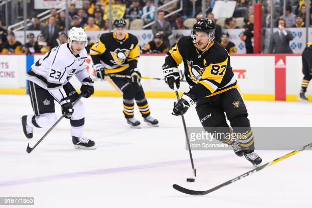 Pittsburgh Penguins Center Sidney Crosby brings the puck into the zone as Los Angeles Kings Right Wing Dustin Brown defends during the first period...