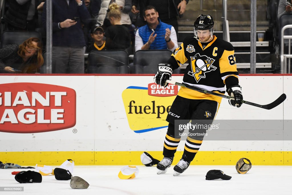 a678c683cd3 Pittsburgh Penguins Center Sidney Crosby celebrates his hat trick ...
