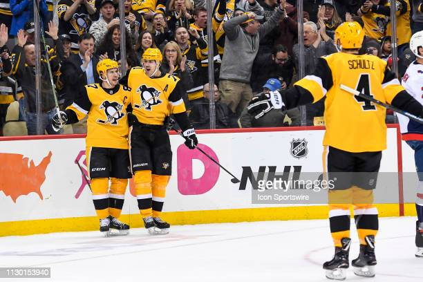 Pittsburgh Penguins Center Sidney Crosby celebrates his power play goal with Pittsburgh Penguins Center Evgeni Malkin during the second period in the...