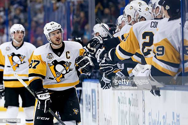 Pittsburgh Penguins center Sidney Crosby is congratulated by teammates on the Pittsburgh Penguins bench after scoring a goal in the first period of...