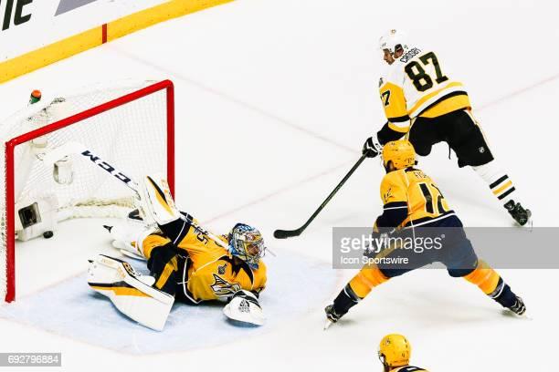 Pittsburgh Penguins center Sidney Crosby scores past Nashville Predators goalie Pekka Rinne during game 4 of the 2017 NHL Stanley Cup Finals between...