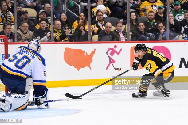 Pittsburgh Penguins Center Sidney Crosby skates with the puck around the net St Louis Blues Goalie Jordan Binnington during the second period in the...