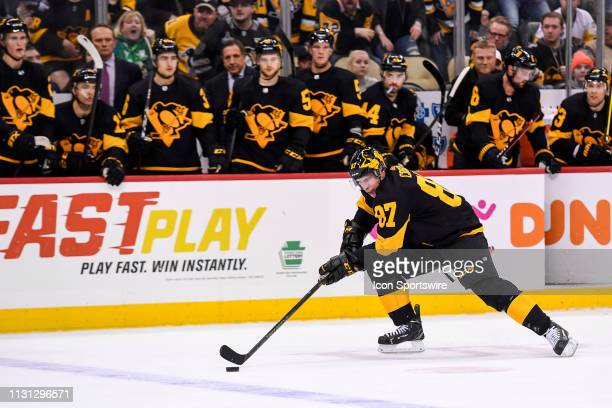Pittsburgh Penguins Center Sidney Crosby skates with the puck during the overtime period in the NHL game between the Pittsburgh Penguins and the...