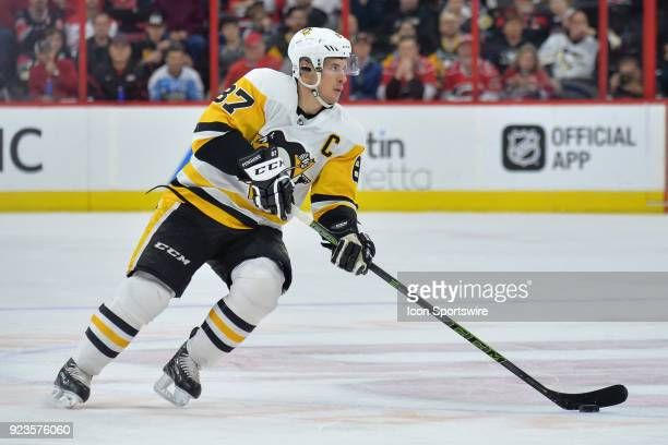 Pittsburgh Penguins Center Sidney Crosby skates with the puck during a game between the Pittsburgh Penguins and the Carolina Hurricanes at the PNC...