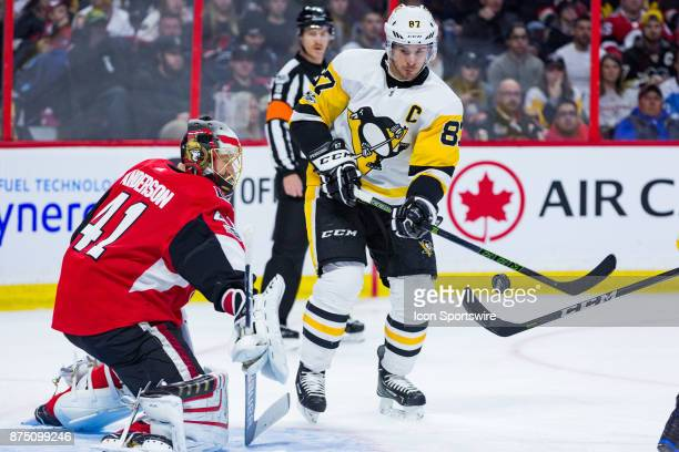 Pittsburgh Penguins Center Sidney Crosby swats at a rebound in front of Ottawa Senators Goalie Craig Anderson during first period National Hockey...