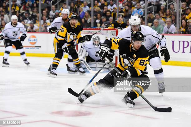 Pittsburgh Penguins Center Sidney Crosby turns with the puck while Los Angeles Kings Center Anze Kopitar defends in front of Los Angeles Kings Goalie...
