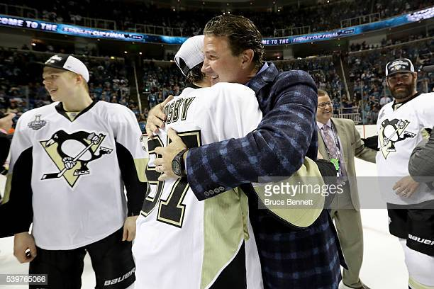 Pittsburgh Penguins Co-owner and Chairman Mario Lemieux celebrates with Sidney Crosby after their 3-1 victory to win the Stanley Cup against the San...