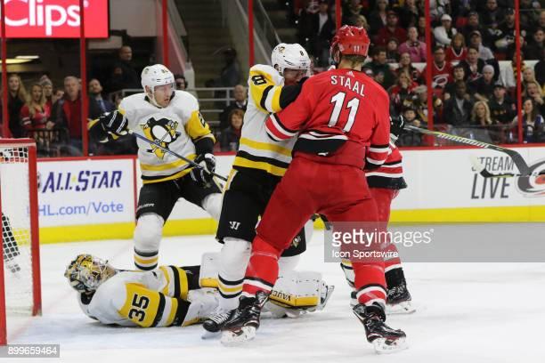 Pittsburgh Penguins Defenceman Brian Dumoulin pushes Carolina Hurricanes Center Jordan Staal during the 1st period of the Carolina Hurricanes game...