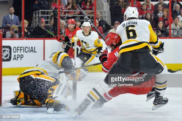 Pittsburgh Penguins Defenceman Jamie Oleksiak takes Carolina Hurricanes Left Wing Brock McGinn to the ice during a game between the Pittsburgh...