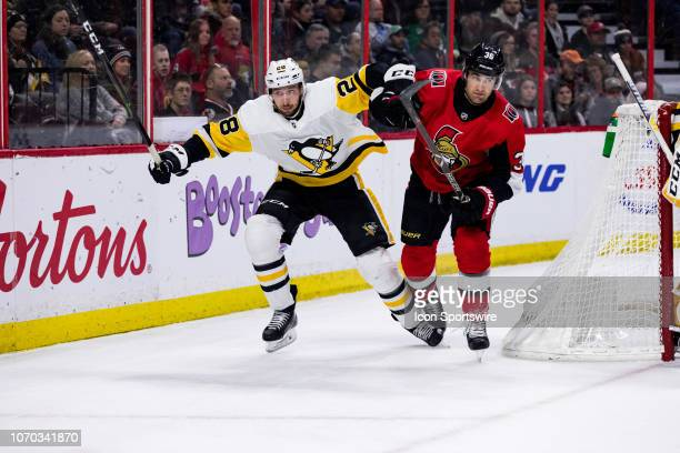Pittsburgh Penguins Defenceman Marcus Pettersson battles Ottawa Senators Center Colin White behind the net during first period National Hockey League...