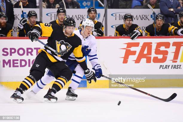 Pittsburgh Penguins Defenseman Brian Dumoulin and Toronto Maple Leafs Right Wing Kasperi Kapanen battle for the puck during the first period in the...