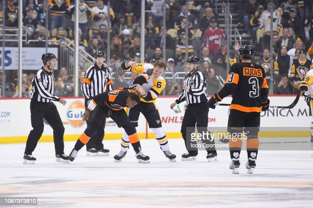 Pittsburgh Penguins Defenseman Jamie Oleksiak and Philadelphia Flyers Right Wing Wayne Simmonds fight during the first period in the NHL game between...