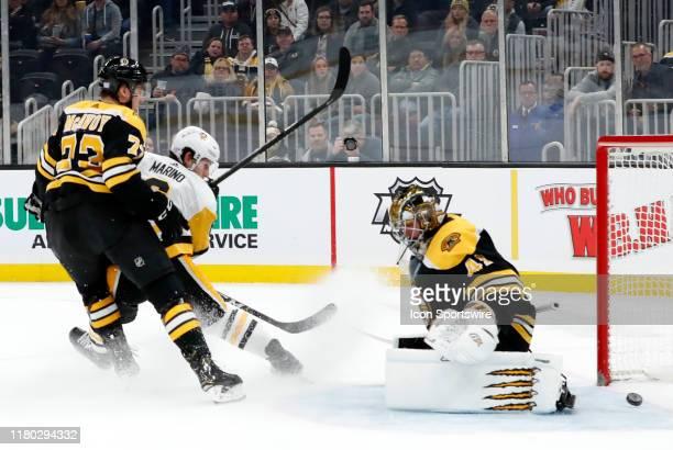 Pittsburgh Penguins defenseman John Marino beats Boston Bruins goalie Jaroslav Halak during a game between the Boston Bruins and the Pittsburgh...