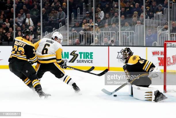 Pittsburgh Penguins defenseman John Marino beats Boston Bruins right defenseman Charlie McAvoy and scores on Boston Bruins goalie Jaroslav Halak...