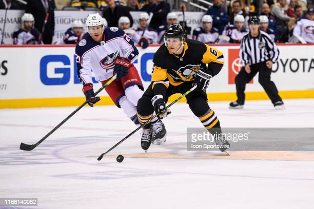 Pittsburgh Penguins Defenseman John Marino brings the puck up ice during the second period in the NHL game between the Pittsburgh Penguins and the...