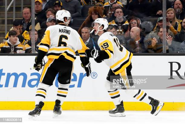 Pittsburgh Penguins defenseman John Marino celebrates his goal with Pittsburgh Penguins left wing Jared McCann during a game between the Boston...