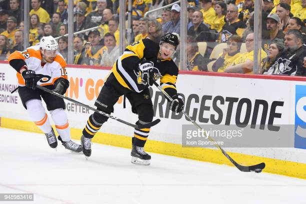 Pittsburgh Penguins defenseman Olli Maatta passes the puck while Philadelphia Flyers left wing Michael Raffl forechecks during the first period The...