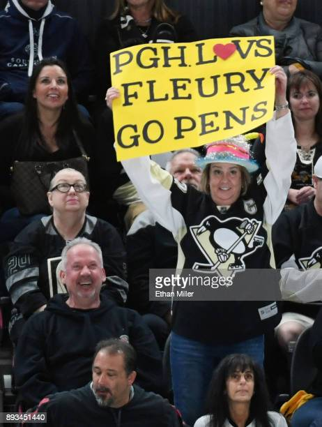 Pittsburgh Penguins fan holds up a sign supporting former Penguin MarcAndre Fleury of the Vegas Golden Knights during the team's game against the...