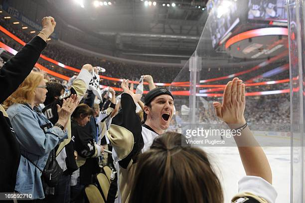 Pittsburgh Penguins fan Mike Link reacts after Evgeni Malkin of the Pittsburgh Penguins scored to give the Penguins a 10 lead over the New York...
