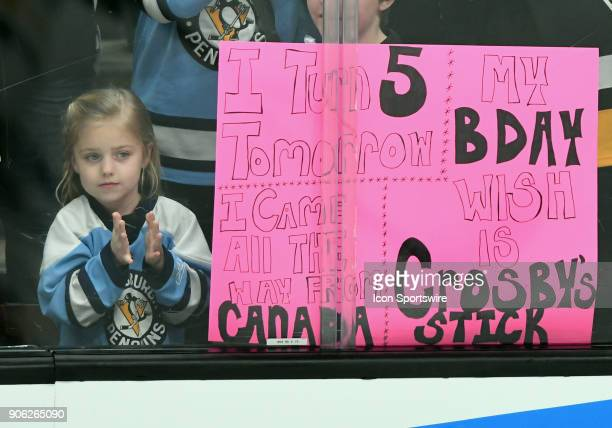 Pittsburgh Penguins fan watches the Penguins warm up next to her birthday sign before a game against the Anaheim Ducks played on January 17 2018 at...