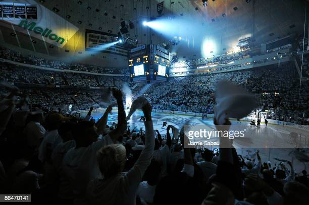 Pittsburgh Penguins fans wave their towels as the Penguins take the ice for Game Three of the Eastern Conference Semifinal Round of the 2009 Stanley...
