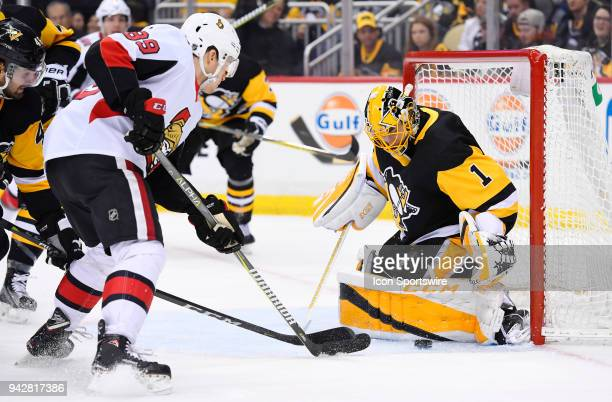 Pittsburgh Penguins Goalie Casey DeSmith makes a pad save on Ottawa Senators Left Wing Max McCormick in front during the third period in the NHL game...