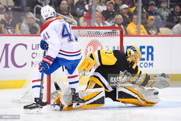 Pittsburgh Penguins Goalie Casey DeSmith makes a save on Montreal Canadiens Winger Paul Byron in front during the first period in the NHL game...