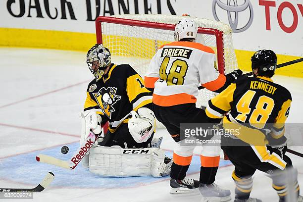 Pittsburgh Penguins goalie Jocelyn Thibeault makes a save on Philadelphia Flyers right wing Danny Briere during a NHL hockey game between the...