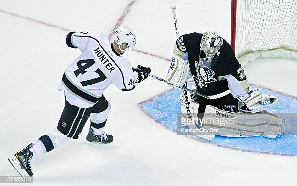 Pittsburgh Penguins goalie MarcAndre Fleury stops a shootout attempt by Los Angeles Kings' Trent Hunter during Tuesday's preseason hockey game on...