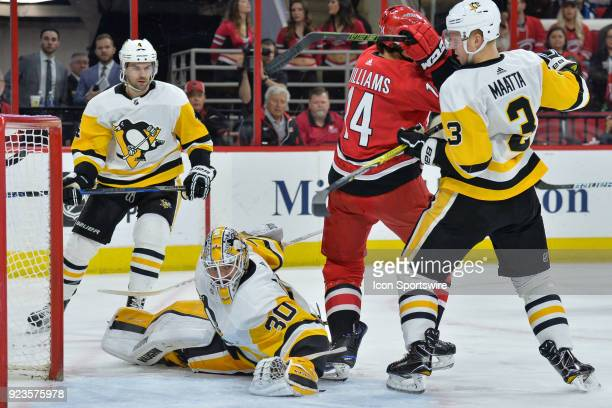 Pittsburgh Penguins Goalie Matt Murray hunts for the puck while screened by Carolina Hurricanes Right Wing Justin Williams and Pittsburgh Penguins...