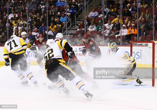 Pittsburgh Penguins goalie Matt Murray makes a save with ice in his face during the NHL hockey game between the Pittsburgh Penguins and the Arizona...