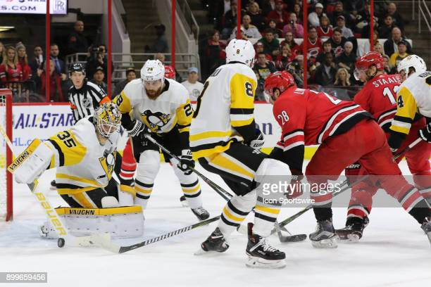 Pittsburgh Penguins Goalie Tristan Jarry blocks the puck while Carolina Hurricanes Right Wing Elias Lindholm tries to scare a goal during the 1st...