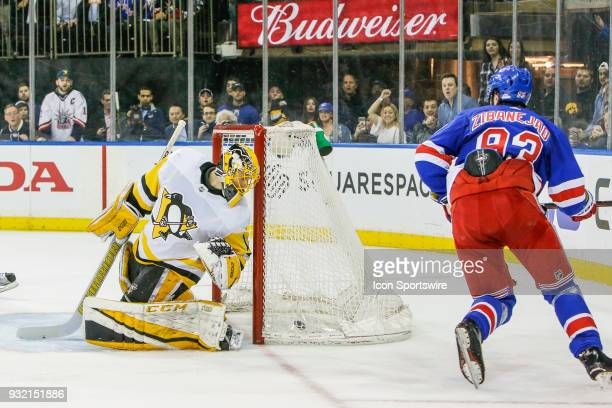Pittsburgh Penguins goaltender Casey DeSmith looks behind him at puck in the net after overtime winning goal by New York Rangers center Mika...